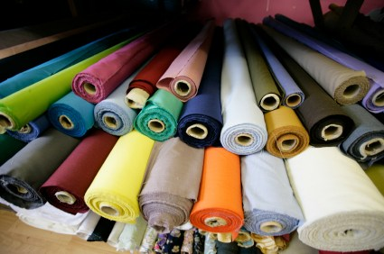 Rolls of brightly coloured fabrics and cloths in a London market. Canon 1Ds Mark 2 file